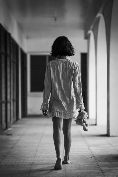 Monochrome Photo Of Woman Standing On Hallway