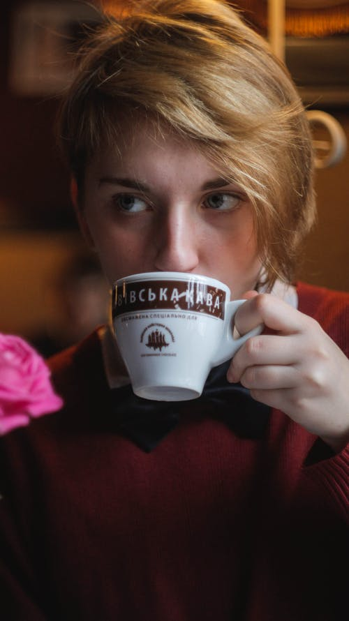 Woman Wearing Red Top Holding Teacup