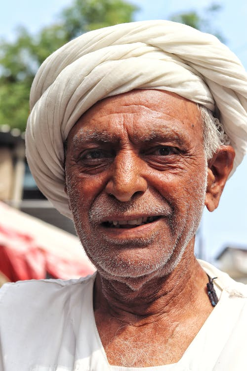 Photo Of Man Wearing White Turban Hat