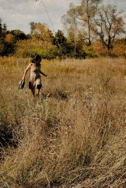 Photo Of Woman Running On Field