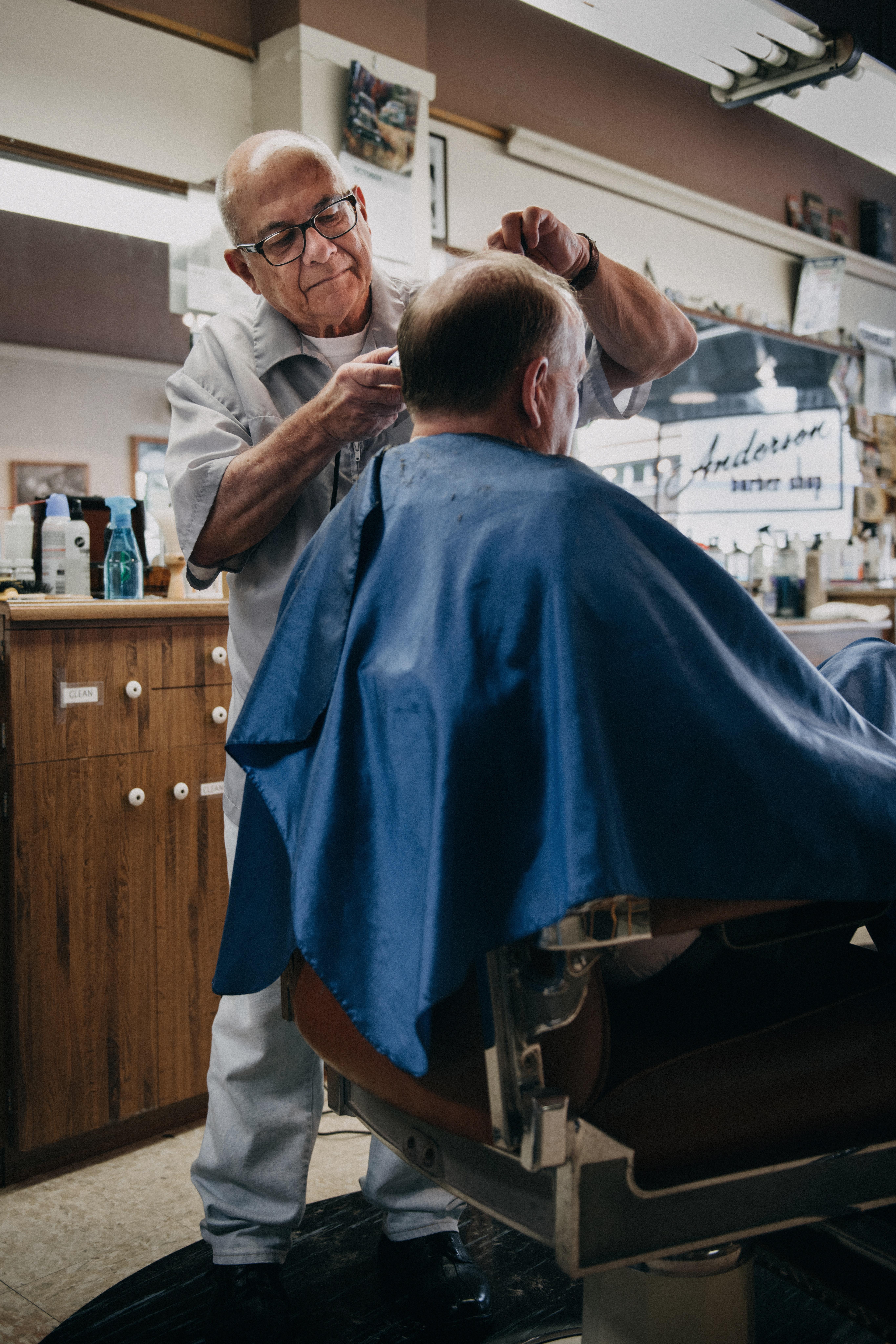 Barber Cutting Man's Hair · Free Stock Photo