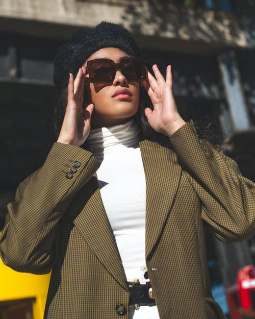 Photo Of Woman Touching Her Sunglasses