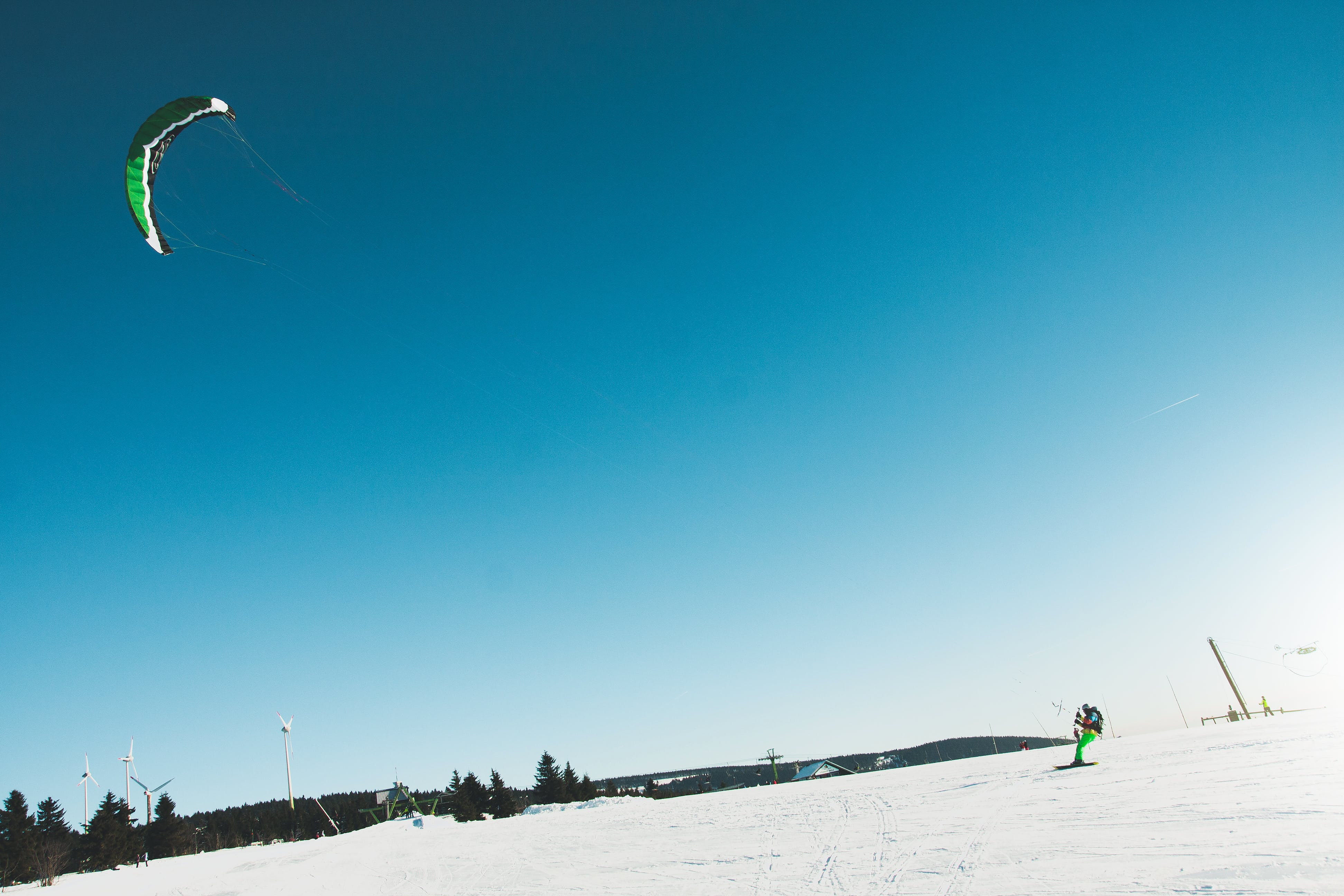 Man Skiing on Snow Covered Landscape