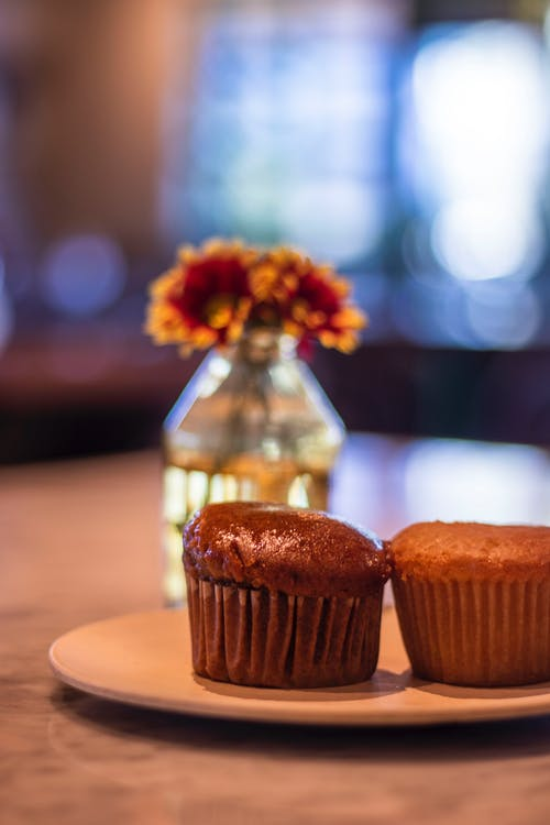 Free stock photo of café, flowers, marble, muffins