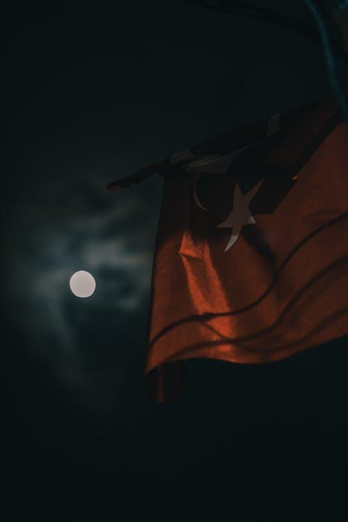 National flag against night sky