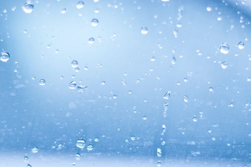 Close-up of Water Droplets Against Blue Background