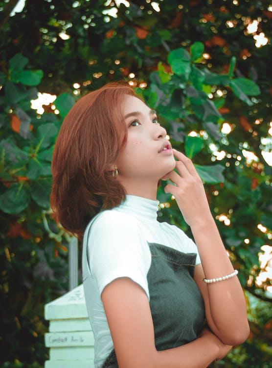 Woman Wearing Black and White Turtleneck Shirt