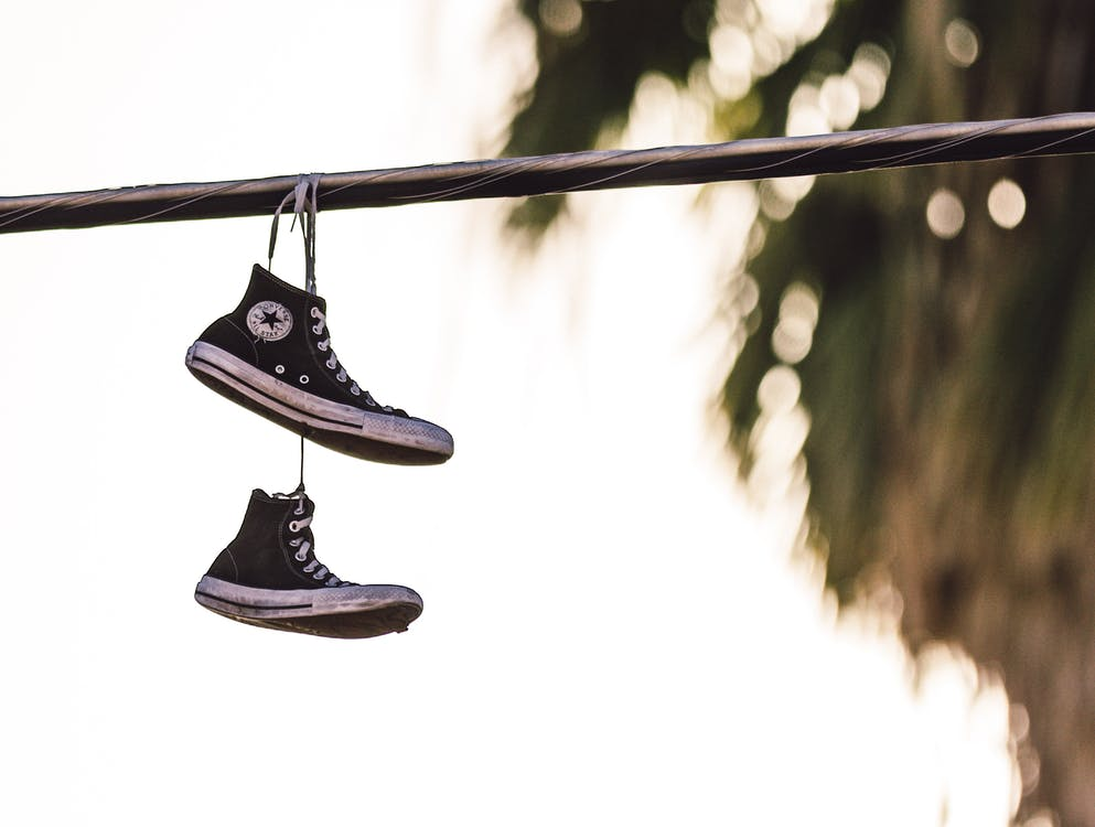 Hanged Pair of Black-And-White Converse All Star Sneakers