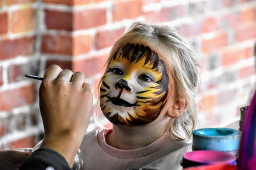 Free stock photo of child, colourful, face paint, hand