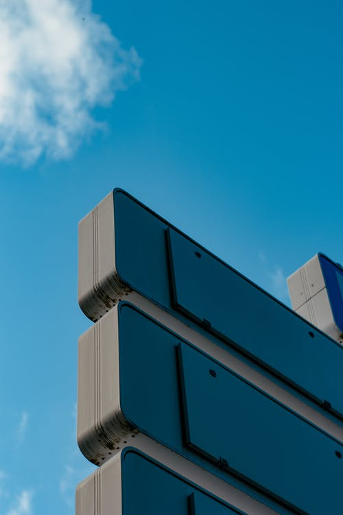 Free stock photo of blue sky, directional sign, panels