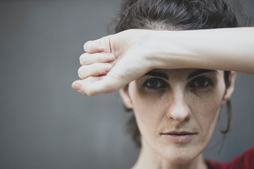 Woman Covering Her Forehead