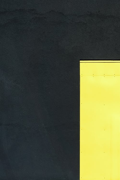 Top view Of A Yellow Flat Metal On A Dark Gray Surface