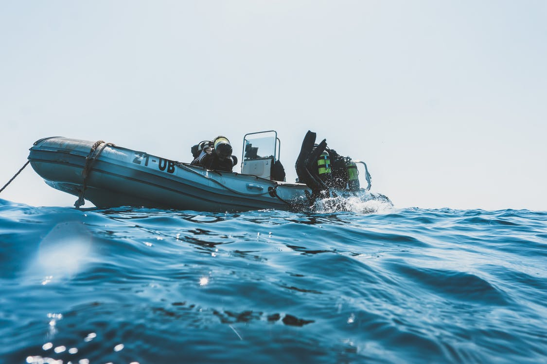 Photo Of Scuba Divers On Boat