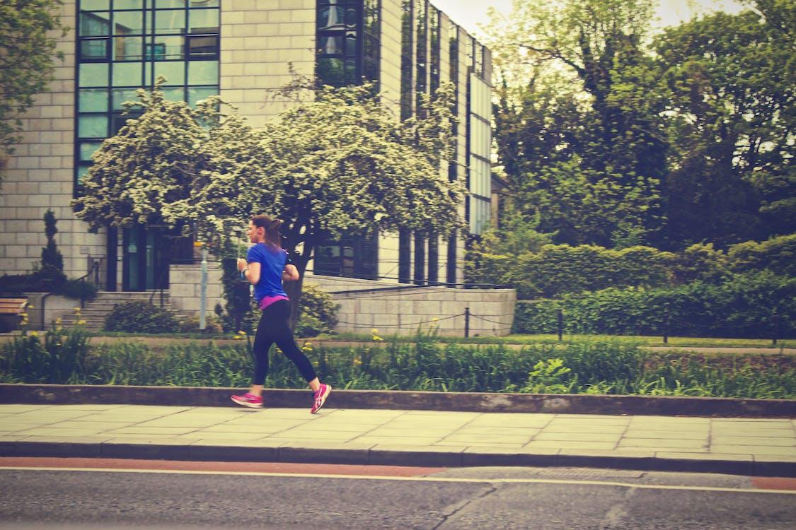 Woman Running Near Plants