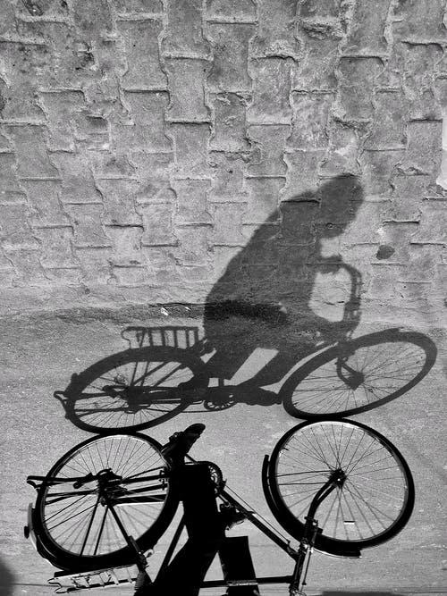 Person's Shadow Riding Bicycle