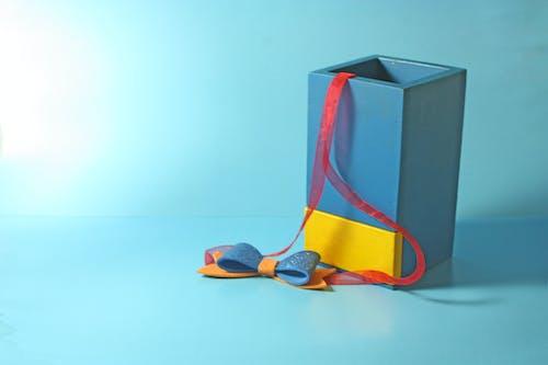 Foto profissional grátis de amarelo, azul, cor, objeto