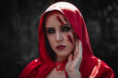 Woman Wearing Red Hood With Makeup