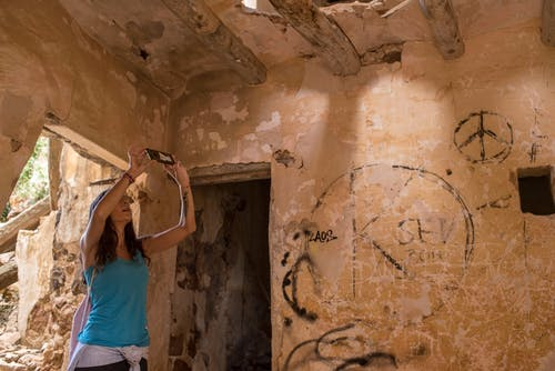 Free stock photo of abandoned building, abandoned house, taking picture, woman