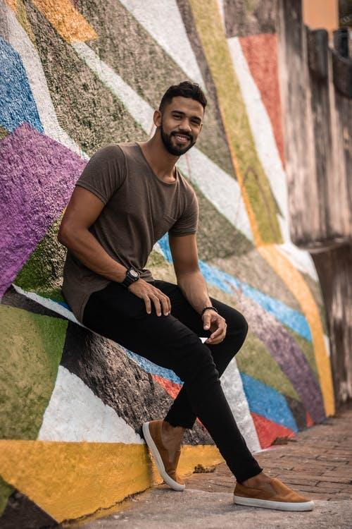 Man in Brown Crew-neck T-shirt and Black Denim Jeans