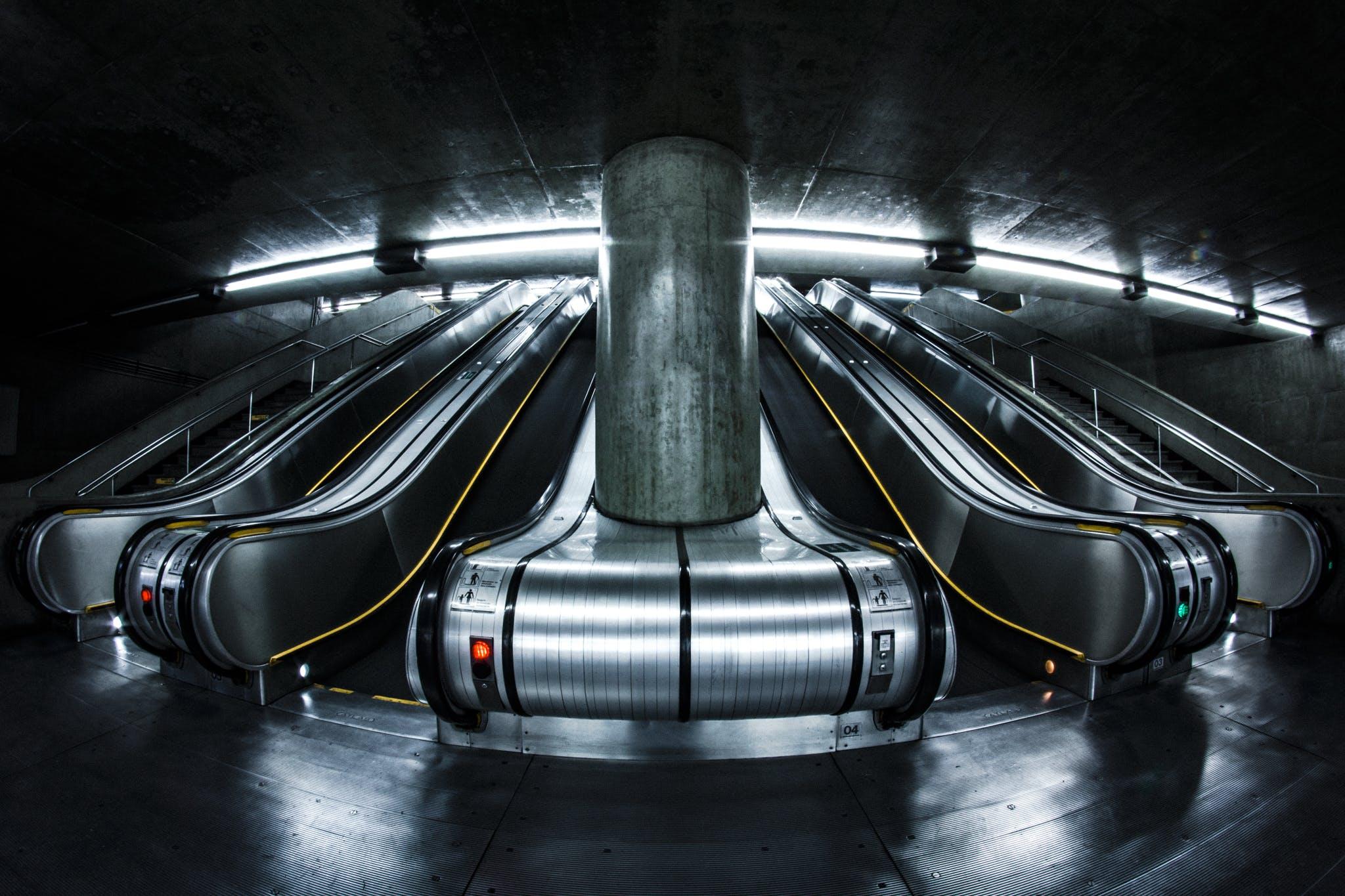Grayscale Photography of Escalators