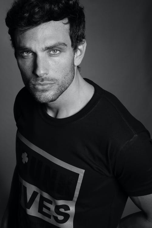 Grayscale Photography Of Man In Crew Neck Shirt