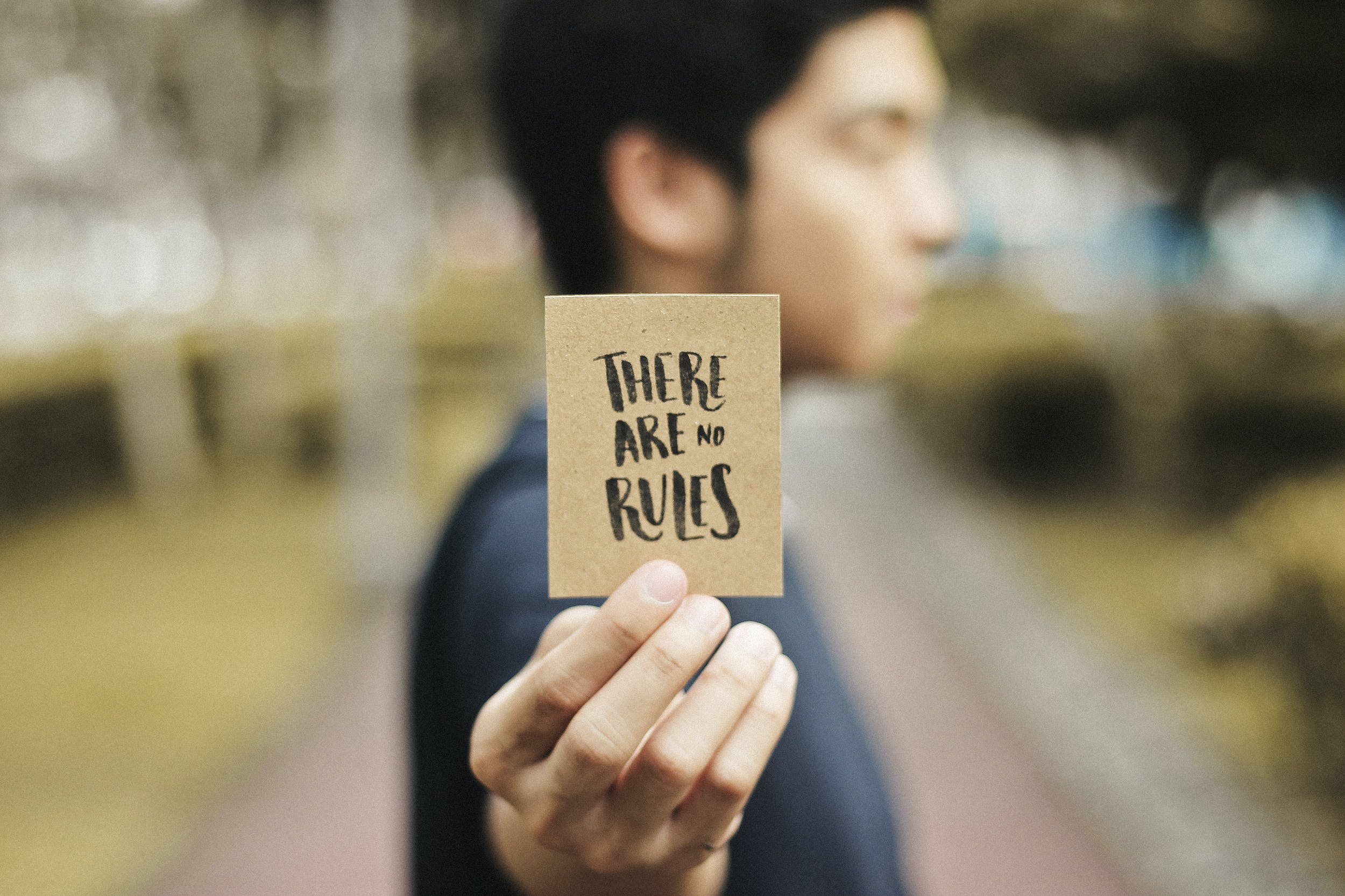 Person Holding Brown Card