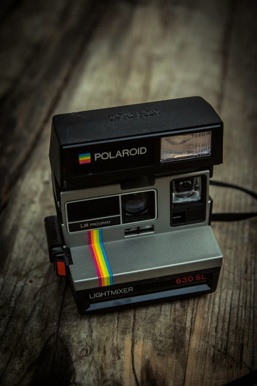 Photo Of Polaroid On Wooden Surface