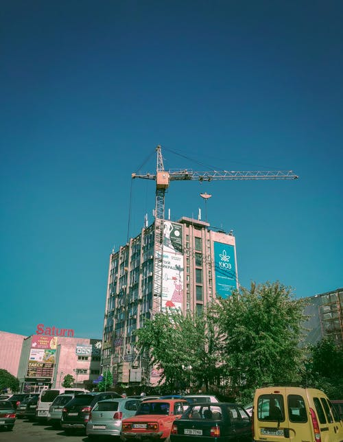 Low Angle Shot Of A Building With A Crane On The Rooftop