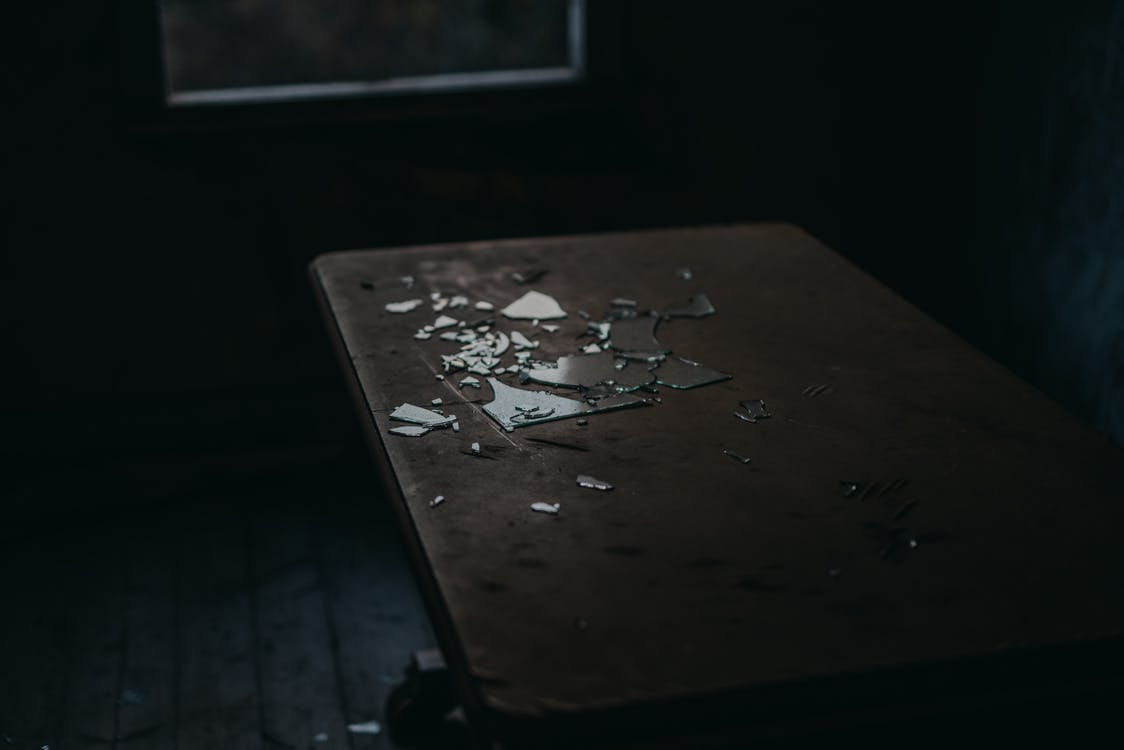 Shards Of Broken Glass On Table