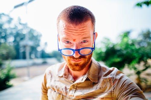 Man Wearing Blue Eyeglasses