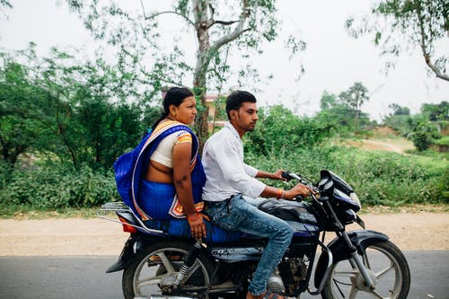 Man and Woman Riding on Motorcycle