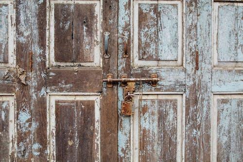 Old Wooden Door With Rusty Padlock