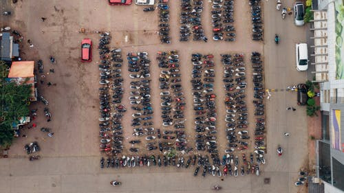 Aerial Photo of Motorcycles on Parking Space