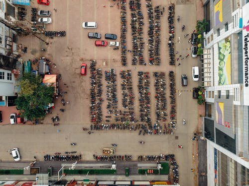 Top View Photo of Motorcycles Parked on Parking Space