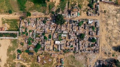 Darmowe zdjęcie z galerii z budynki, domy, fotografia lotnicza, fotografia z drona