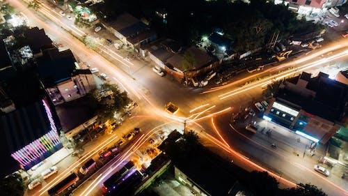 Безкоштовне стокове фото на тему «drone камери, вечір, вогні міста, довга експозиція»