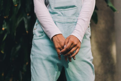 Person Wearing Long-sleeved Shirt and Teal Pants