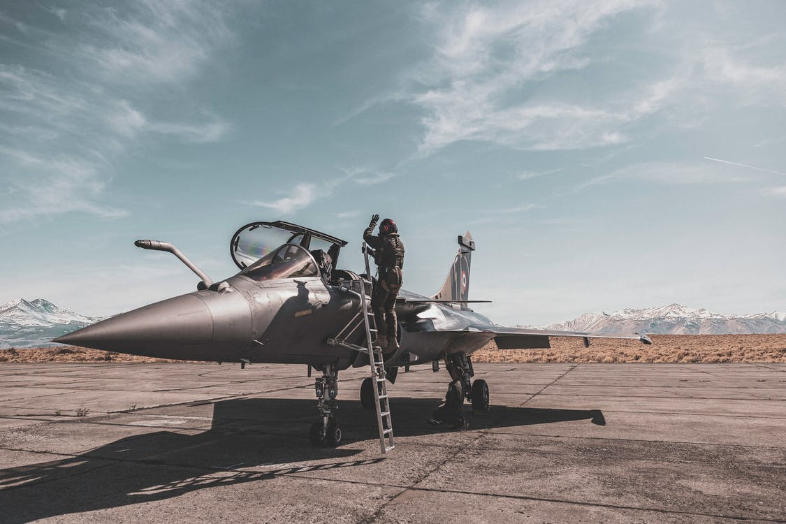 Photo Of Person Standing Beside Fighter Jet