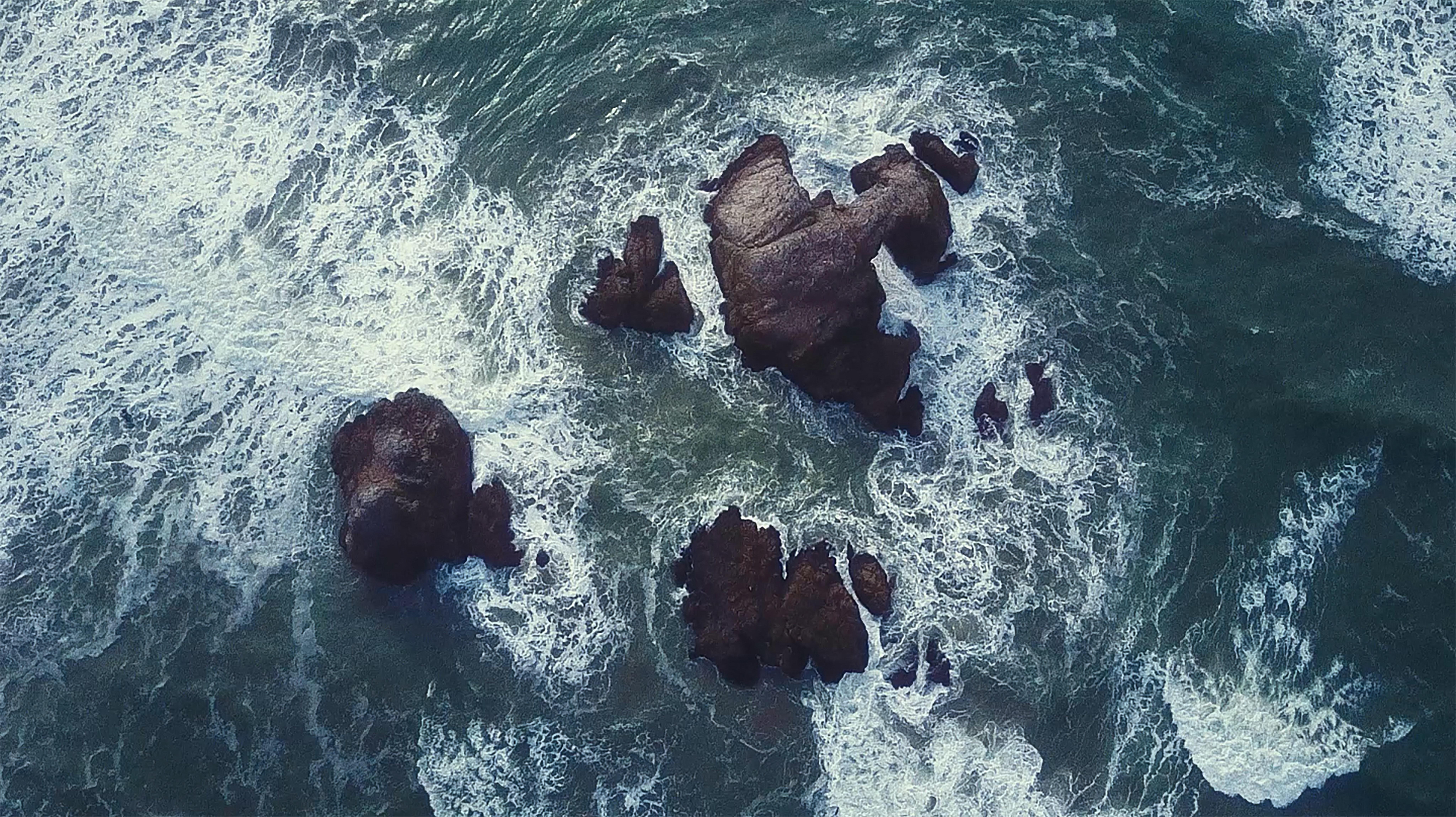 Splashing Wave On Rock Free Stock Photo