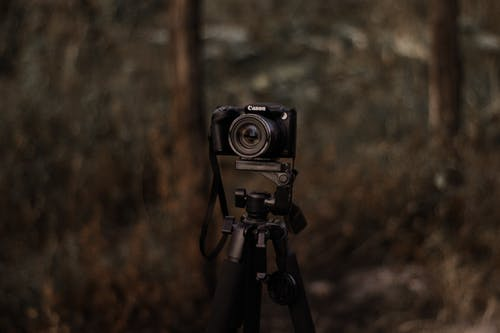 Shallow Focus Photo of Black Dslr Camera on Tripod