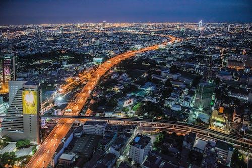 Безкоштовне стокове фото на тему «drone камери, будівлі, вежі, вечір»