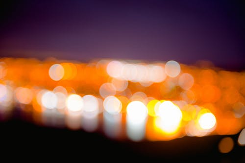 Bokeh Photography of White and Orange Lights