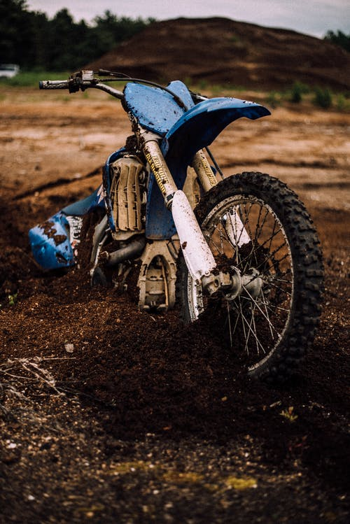 Blue Motocross Dirt Bike on Mud