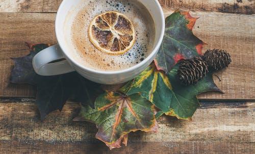 White Teacup on Leaves