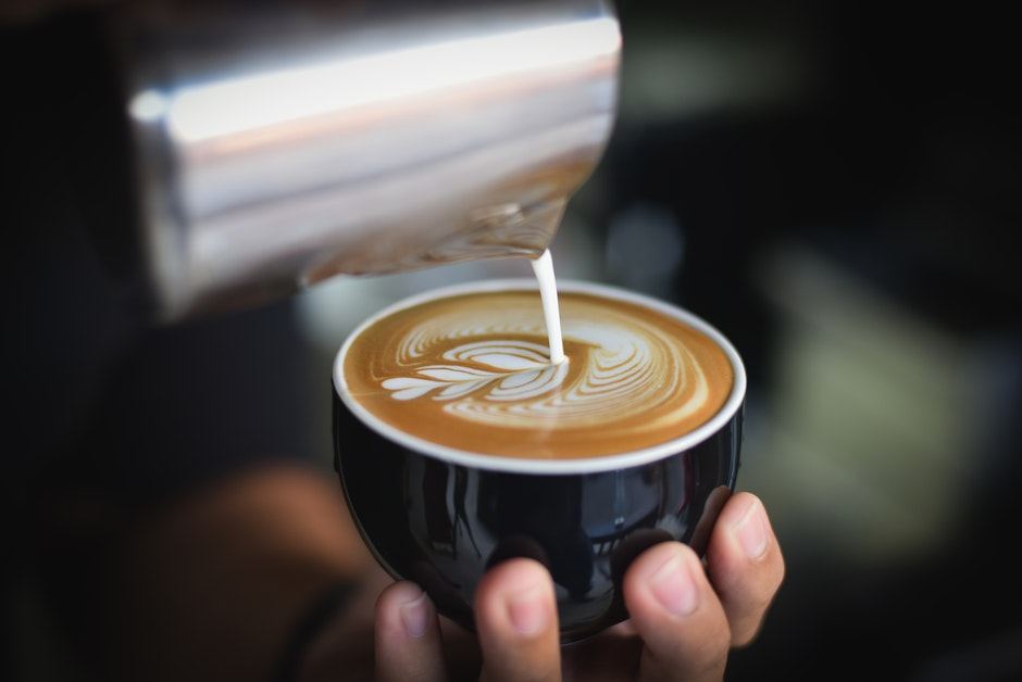Close-up of Woman Holding Coffee Cup at Cafe