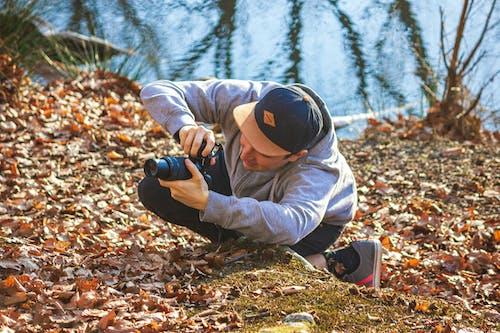 Free stock photo of beanie, camera, camera lens