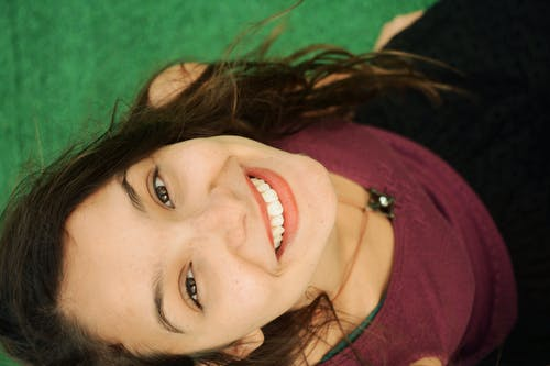 Top-view Photography of Smiling Woman