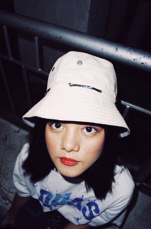 Woman Wearing White Bucket Hat