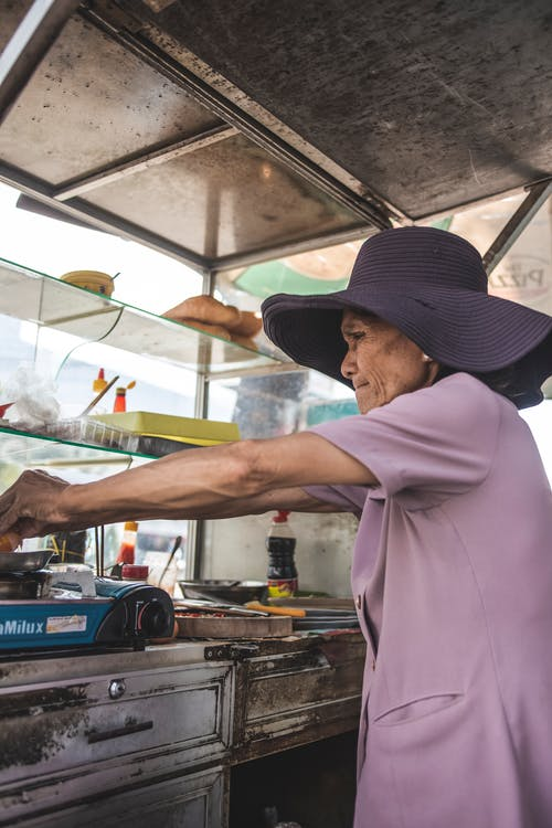 Photo Of An Old Woman Wearing Purple Top