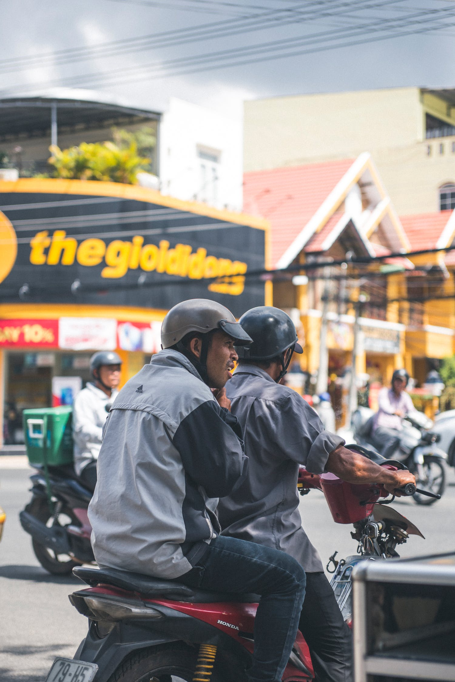 Two Men Riding on Motorcycle